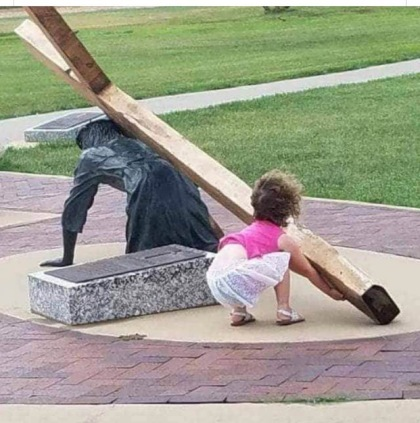 girl carrying the cross